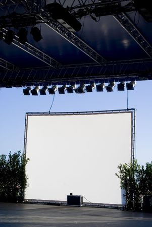 ad: White background on a stage at open air