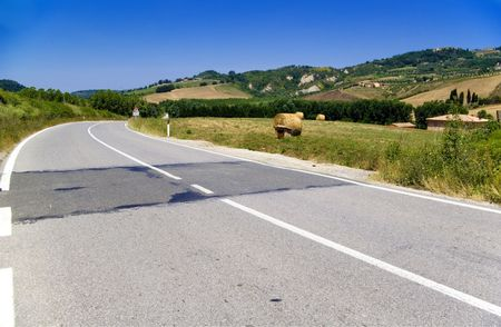 Curved street in the countryside of Chianti in Tuscany photo