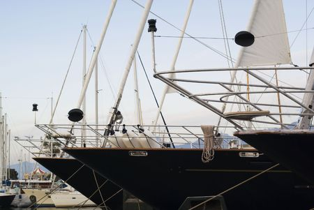 Row of extra large yacht in aport