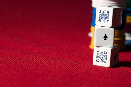 pokers: Pokers Dice and chips on a red cover. Stock Photo