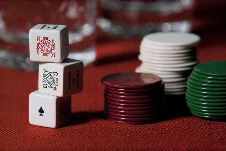 pokers: Pokers Dice and chips on a red cover. Editorial