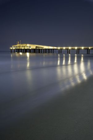 showed: Nightview of coastline in italy in full night with a long exposure tecnique. A long modern brand new pier showed