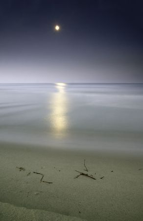 moonlighting in the sea, long eposure o capture the beauty of this nightscene Stock Photo - 3256027