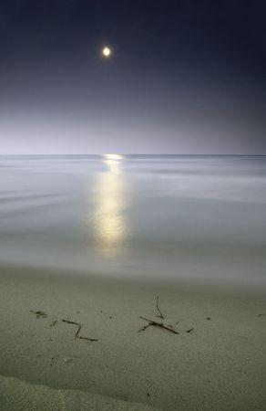 moonlighting in the sea, long eposure o capture the beauty of this nightscene Stock Photo - 3256027