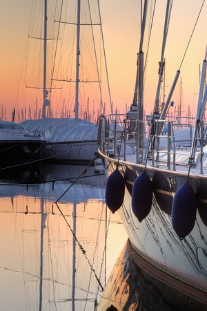 extra large: Extra Large Luxury yachts rest in the port at sunset Stock Photo