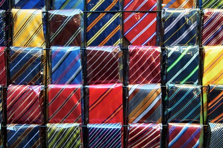 rows of colored neckties are displayed in the market of San Lorenzo,Florence