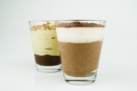 kilo: Two glasses Of Chocolate Mousse on a white background