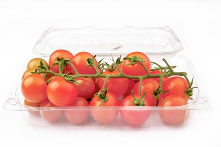 Close up of some Cherry tomatoes on a plastic bag isolated on white background