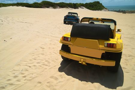 Colored dune buggys parked in the dunes of geipabu, Natal,Brazil