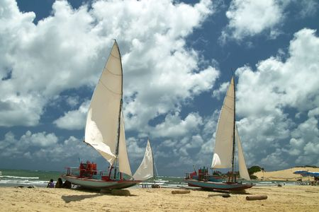 Typical brazilian boat with triangular shaped sail in a beach near natal, brazil