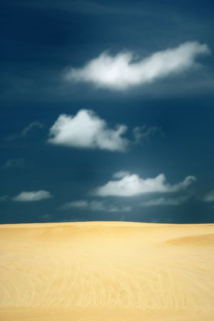unspoiled: Unspoiled beautiful dunes of genipabu against a deep blue sky with white clouds, Natal. brazil Stock Photo