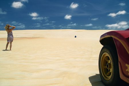 Blonde girl relaxing during a buggy tour in the sand dunes near natal.