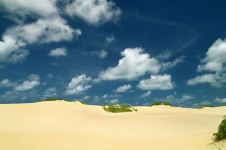 escaping: Unspoiled beautiful dunes of genipabu against a deep blue sky with white clouds, Natal. brazil Stock Photo