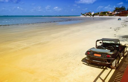Colored dune buggys parked in the beach of maracuja, Natal,Brazil