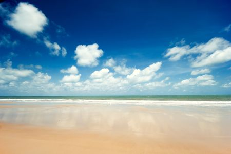 Exotic beach with a deep blue sky photo