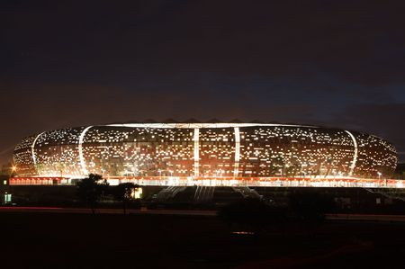 South africa will host the 2010 world cup of soccer. Jewel of the crown is the soccer city in soweto-johannesburg, and the stadium capable of 80000 people will host the first and final match of the competition. Here a nightshot of the stadium. Editorial