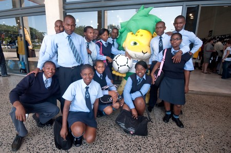DURBAN - APRIL  5:  a group of balack southafrican student pose with zakumi mascotte of the next soccer world cup, here a giant reproduction, april 5, 2010 Durban, South Africa
