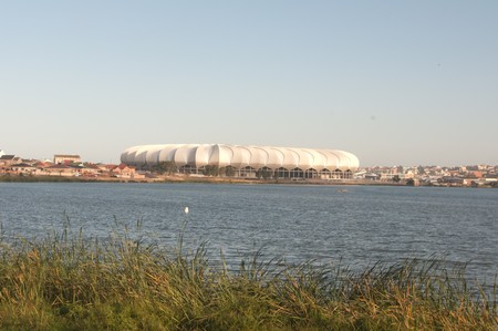 newsworthy: PORT ELIZABETH - APRIL 20 2010:South Africa will host the next soccer world cup. The north end lake with the beautiful new Porth Elizabeth stadium dedicated to Nelson Mandela, in porth elizabeth , South