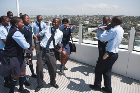 stadium  durban: DURBAN - MAY 04: Vuvuzuela is the trumpet of south african soccer fans.  A group of southafrican student singing it at the durban new stadium, may 04 2010 in Durban, SouthAfrica Editorial