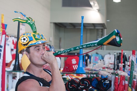 stadium  durban: DURBAN - MAY 04: Vuvuzela is the trumpet of south african soccer fans.  A brazilian is showing how to sing it at the durban new stadium, may 04 2010 in Durban, SouthAfrica