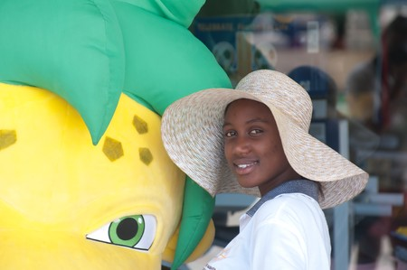 DURBAN - APRIL  5: tnice african girl poses near the official mascotte of fifa world cup Zakumi, april 5, 2010 Durban, South Africa