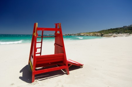 safeguard: Red safeguard cabin isolated in the beautiful beach of camps bay with a marvelous emerald sea in the background in cape town