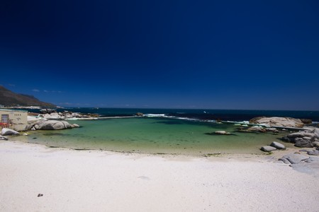 Little bay near the beach of camps bay with a marvelous emerald sea in the background in cape town, Stock Photo