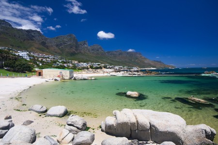 Little bay near the beach of camps bay with a marvelous emerald sea and the twelve apostles mountain in the background photo