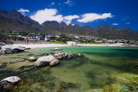 Little bay near the beach of camps bay with a marvelous emerald sea and the twelve apostles mountain in the background Stock Photo