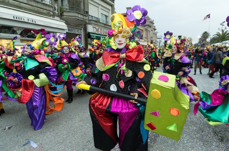 newsworthy: VIAREGGIO, ITALY - FEBRUARY 27: Man smiling in carnival mask, during the famous Carnival of Viareggio February 27, 2011 in Viareggio, Italy