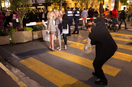 CANNES, FRANCE - MAY 15: freelance photographer take photos of people in the croisette  during the 64th Annual Cannes Film Festival on May 15, 2011 in Cannes, France.