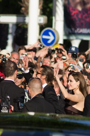 CANNES, FRANCE - MAY 16: Actor Brad Pitt and Angelina Jolie says hello to fans at the  The Tree Of Life premiere during the 64th Annual Cannes Film Festival at Palais des Festivals on May 16, 2011 in Cannes, France