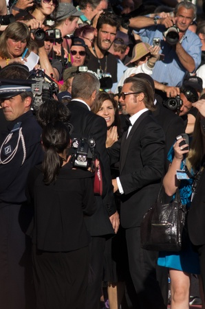 brad pitt: CANNES, FRANCE - MAY 16: Actor Brad Pitt says hello to fans at the  The Tree Of Life premiere during the 64th Annual Cannes Film Festival at Palais des Festivals on May 16, 2011 in Cannes, France