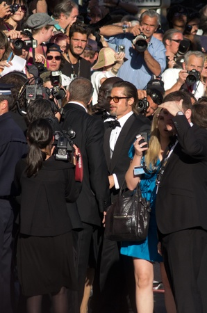 CANNES, FRANCE - MAY 16: Actor Brad Pitt says hello to fans at the  'The Tree Of Life' premiere during the 64th Annual Cannes Film Festival at Palais des Festivals on May 16, 2011 in Cannes, France Stock Photo - 9556396