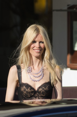 martinez: CANNES,FRANCE-MAY 20: german top model claudia schiffer is spotted leaving  hotel martinez in cannes during the film festival on may 20th in Cannes, France