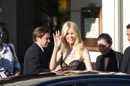 martinez: CANNES, FRANCE - MAY 20: Claudia Schiffer waves at fans as she is spotted leaving the Martinez hotel on May 20, 2011 in Cannes, France