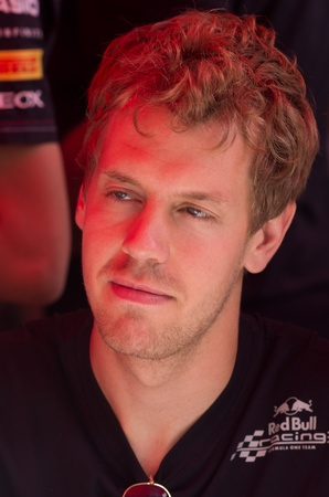 vettel: MONACO, FRANCE-MAY 28: driver sebastiana vettel signs autograph to fans at the end of the qualify for the grand prix of monaco on 28th, 2011 of may in Monaco, france