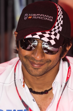 qualify: MONACO, FRANCE-MAY 28: indian driver of hispano racing Narain Karthikeyan signs autograph to fans at the end of the qualify for the grand prix of monaco on 28th, 2011 of may in Monaco, france Editorial