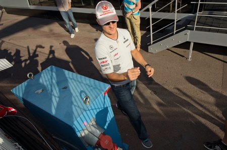 qualify: MONACO, FRANCE-MAY 29: driver michael schumacher signs autograph to fans at the end of the qualify for the grand prix of monaco on 29th, 2011 of may in Monaco, france Editorial