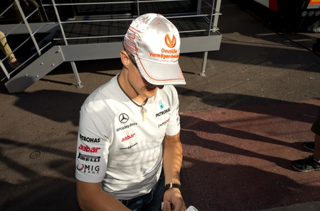 MONACO, FRANCE-MAY 29: driver michael schumacher signs autograph to fans at the end of the qualify for the grand prix of monaco on 29th, 2011 of may in Monaco, france Editorial