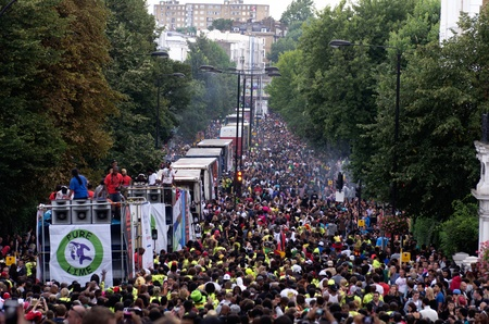 LONDON - AUG 28: view of  ladbroke Grove street full of reveillers during the  Notting Hill Carnival on August 29, 2011 in London, England. The annual carnival,  the largest in Europe, takes place every August Bank Holiday since 1966.