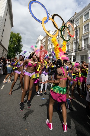 olympic ring: LONDON - AUG 29: Performers parade in the street of  Notting Hillfir the annual carnival with the five olympics ring, on August 29, 2011 in London, England.London will host the next olympic games in 2012
