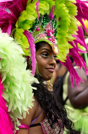 LONDON - AUG 29: Performer takes part in the Notting Hill Carnival on August 29, 2011 in London, England. The annual carnival,  the largest in Europe, takes place every August Bank Holiday since 1966. Editorial