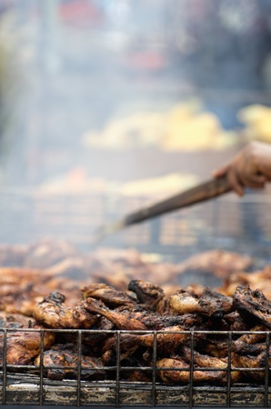 british foods: chicken wings cooked in a food stall during the notting hills carnival, London