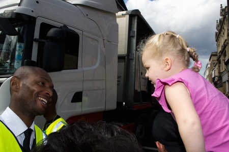 safest: LONDON - AUG 28: black security man smiles a t a blonde child during the  Notting Hill Carnival on August 29, 2011 in London, England. The annual carnival,  has been one of the safest in the history.