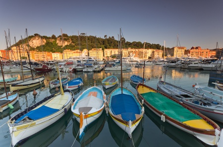 Old classic wooden boats and luxury yachts rest in the old port of Nice , cote azur, France Editorial