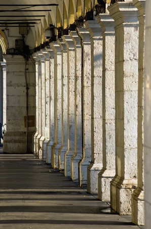 row of columns in shade in place massena early in the morning, Nice, France