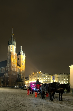 The Main Market Square in Cracow is the most important square of the Old Town in Cracow, Poland  In the background is St  Mary photo