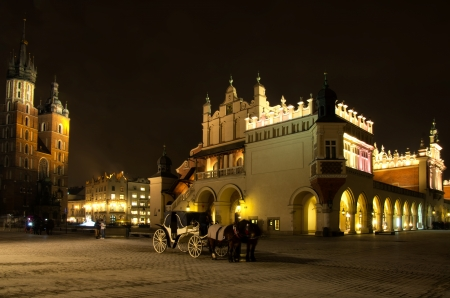 The Main Market Square in Cracow is the most important square of the Old Town in Cracow, Poland  In the background is St  Mary Stock Photo - 16855307