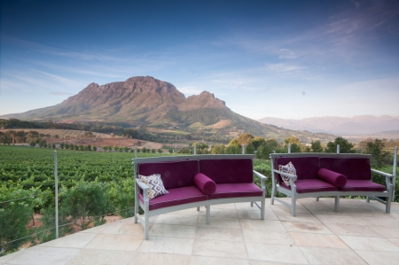 Posh restaurant ia a Vineyards in Stellenbosch, Western Cape, South Africa. Simonsberg mountain range as a backdrop. In the last year Stock Photo